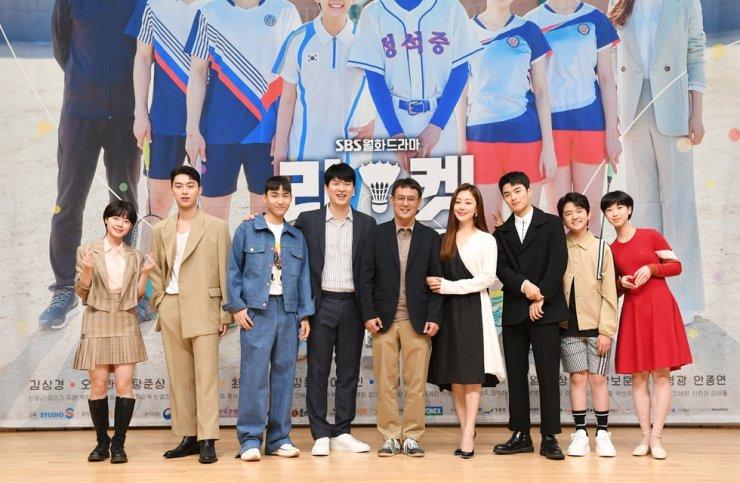 Actors Lee Jae-in, from left, Choi Hyun-wook, Tang Jun-sang and Kim Sang-kyung, director Jo Yeong-gwang, and actors Oh Na-ra, Son Sang-yeon, Kim Kang-hoon and Lee Ji-won pose for pictures during the online press conference for 'Racket Boys,' Tuesday. Courtesy of SBS