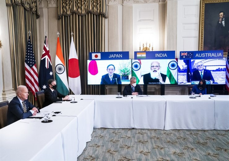 U.S. President Joe Biden, left, participates in a Quad summit remotely with Indo-Pacific nation leaders at the White House, Washington, D.C., March 12. Reuters-Yonhap