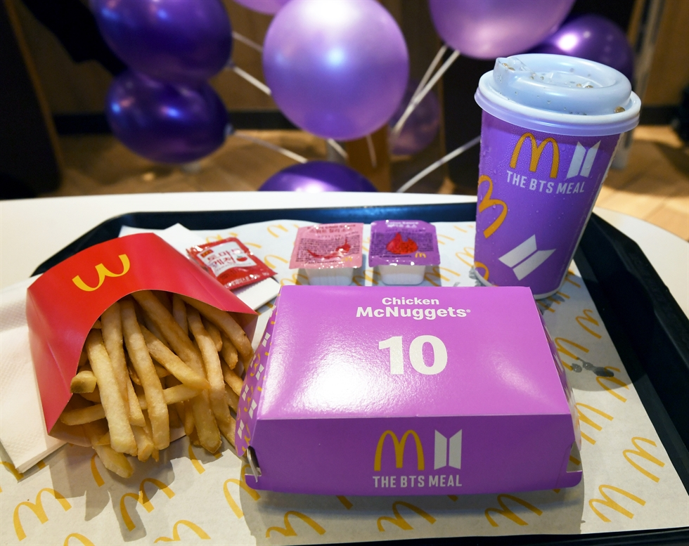 BTS fans take photos with The BTS Meal at a McDonald's in Seoul on May 27. / Korea Times photo by Hong In-kee