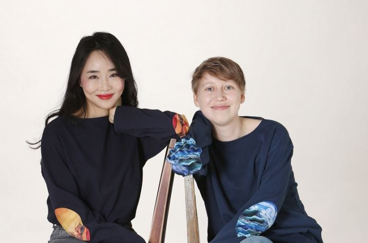 Kang Ji-hyun, left, and Marie Boes, founders of social impact fashion brand ISTORY / Courtesy of ISTORY