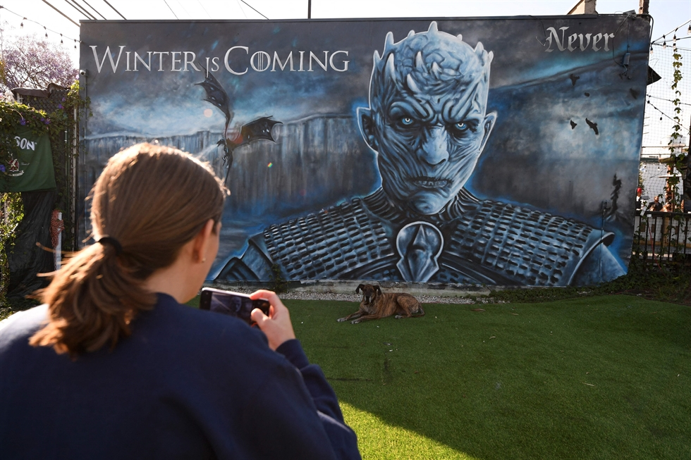 AT&T logo is seen on a smartphone in front of displayed Discovery and Warner Media logos in this illustration. Reuters-Yonhap