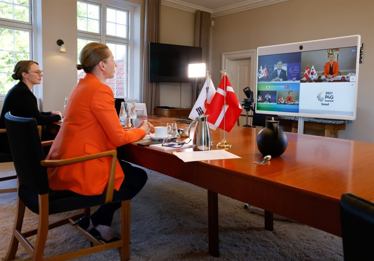 Danish Prime Minister Mette Frederiksen, right, attends a virtual summit with Korean President Moon Jae-in, May 30. The two heads of states agreed to elevate the ties between the two nations to a 'comprehensive green strategic partnership,' reflecting cooperation in the fields of sustainability, life science, healthcare, technology and innovation, as well as political and economic collaboration. Courtesy of Embassy of Denmark in Korea