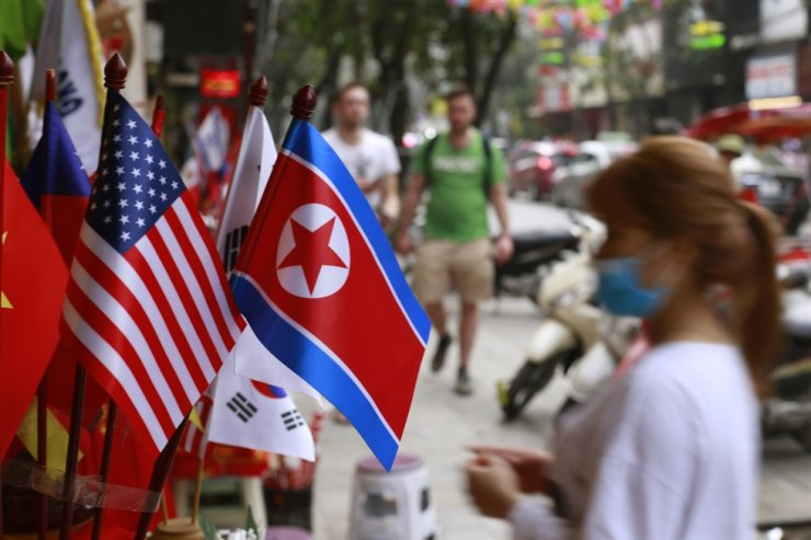 The U.S. flag and the North Korean flag are put together at a store in Hanoi, Vietnam, in this 2019 February file photo. AP-Yonhap
