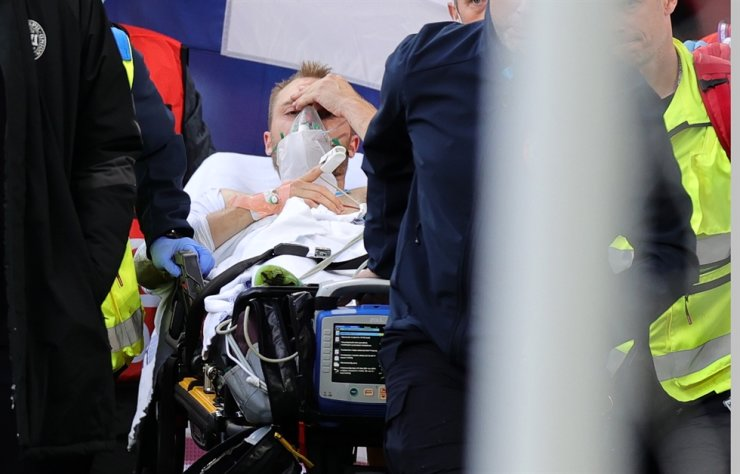 Christian Eriksen of Denmark is stretchered off the pitch after receiving medical assistance during the UEFA EURO 2020 group B preliminary round football match between Denmark and Finland in Copenhagen, Denmark, June 12. EPA-Yonhap
