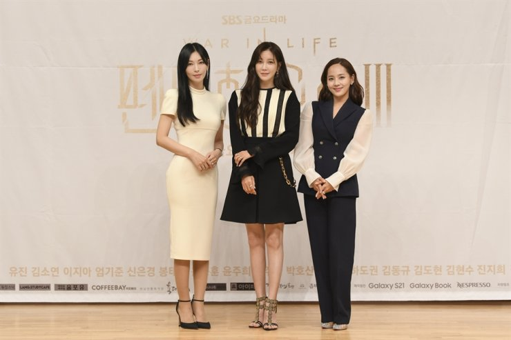 From left, actors Kim So-yeon, Lee Ji-ah and Eugene pose during an online press conference for 'The Penthouse: War in Life 3,' Friday. Courtesy of SBS