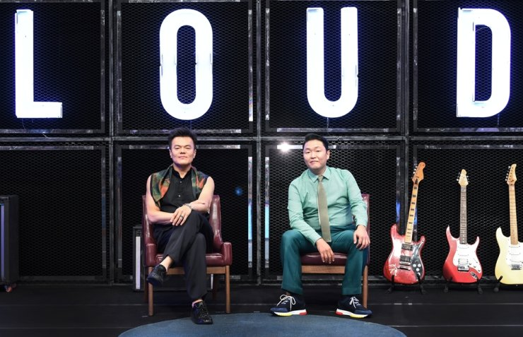 Singers and producers Park Jin-young, left and Psy pose for pictures during an online media conference for the new audition show 'LOUD,' Thursday. Courtesy of SBS