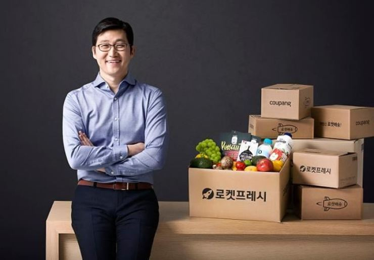 Coupang founder Kim Bom poses next to boxes containing fresh food at the company's headquarters in Seoul in this 2020 file photo. Courtesy of Coupang