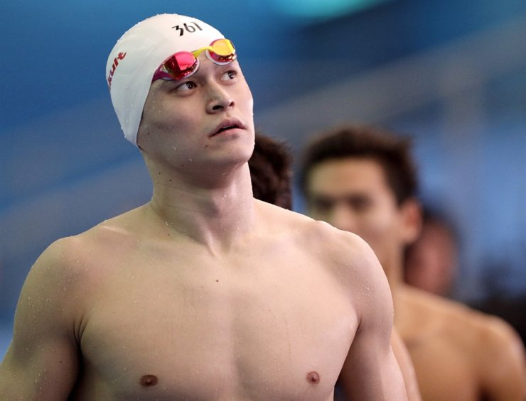 In this July 26, 2019, file photo, China's Sun Yang leaves the pool deck following the men's 4x200m freestyle relay heats at the World Swimming Championships in Gwangju, Korea. Sun has been banned for more than four years for breaking anti-doping rules. AP-Yonhap
