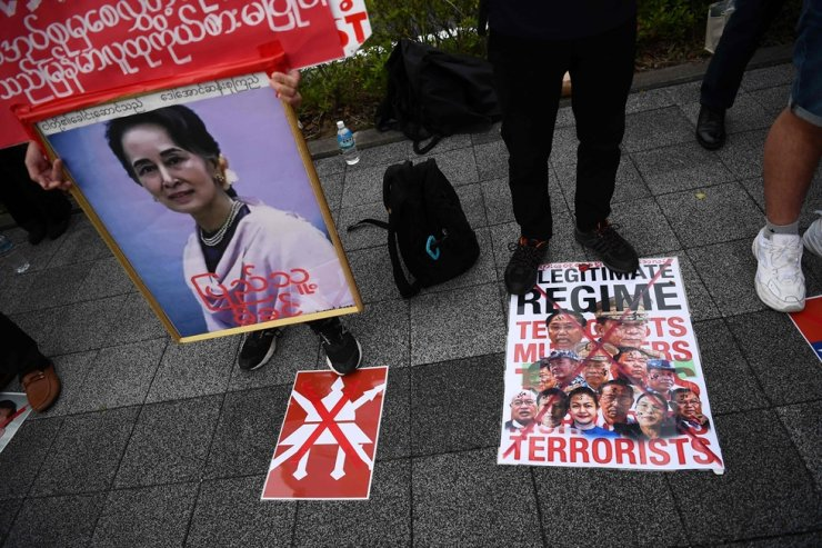Demonstrators protest against the military coup in Myanmar outside Fukuda Denshi Arena stadium in Chiba, ahead of the FIFA World Cup Qatar 2022 Asian zone group F qualification football match between Japan and Myanmar. AFP-Yonhap