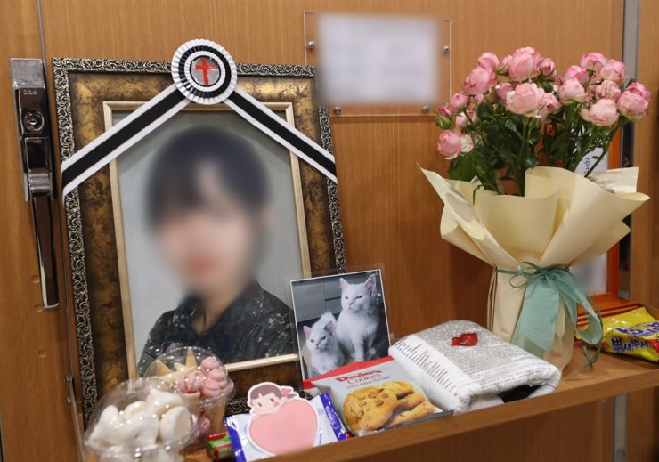 Portrait of the Air Force officer, who died in an apparent suicide following alleged sexual assault by a colleague, is displayed at her funeral in Seongnam, Gyeonggi Province, June 3. Yonhap