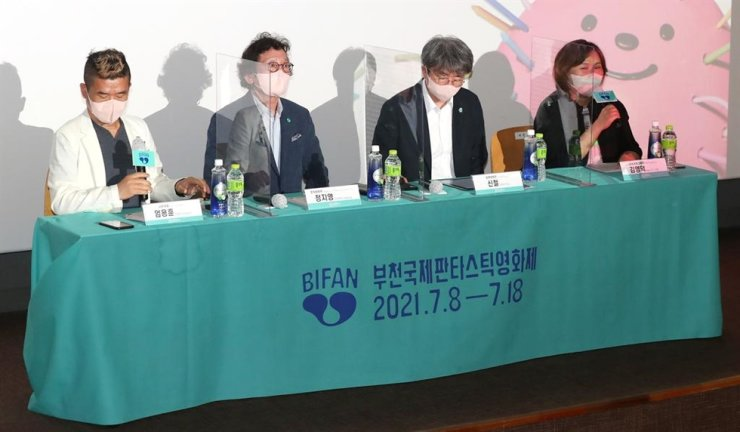 From left, the BIFAN Organizing Committee General Manager Eom Yong-hoon, Chairman Jung Ji-young, Festival Director Shin Chul and Head Programmer Ellen Y.D. Kim attend a press conference for the 25th Bucheon International Fantastic Film Festival, scheduled July 8-18.  Yonhap