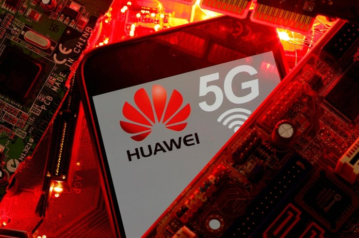 A smartphone with the Huawei and 5G network logo is seen on a PC motherboard in this illustration picture taken Jan. 29, 2020. Reuters-Yonhap