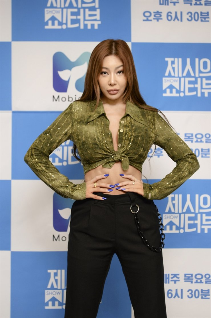 Jessi, singer and the host of 'Showterview with Jessi,' poses for pictures during an online media conference, Monday, held to celebrate the show's one-year anniversary. Courtesy of SBS