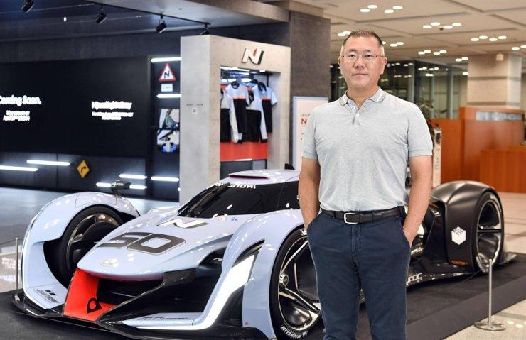 Hyundai Motor Group Chairman Chung Euisun stands next to a high-performance N brand series race car. Courtesy of Hyundai Motor Group