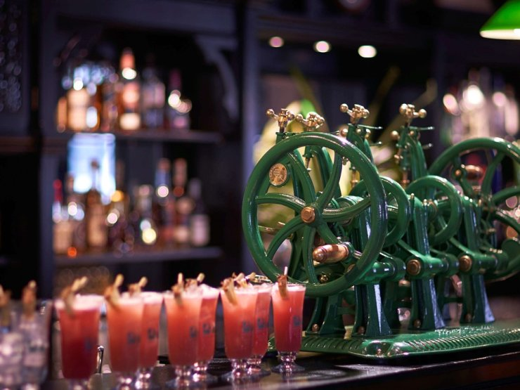 Glasses of the Singapore Sling are on a bar in Singapore. Courtesy of Booking.com