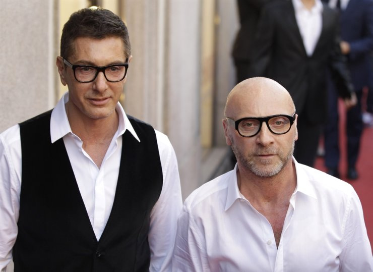 In this 2011 May file photo, fashion designers Stefano Gabbana, left, and Domenico Dolce arrive in downtown Milan, Italy. AP-Yonhap