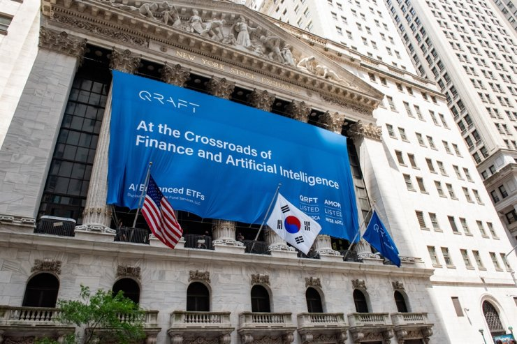 A banner celebrating the listing of Qraft Technologies' artificial intelligence-powered exchange-traded funds on the New York Stock Exchange is seen in this July 2019 file photo. Courtesy of Qraft Technologies