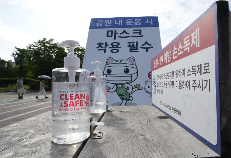 Bottles of hand sanitizer are displayed for use at a park in Goyang, June 15. AP-Yonhap