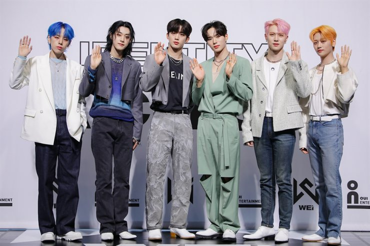From left, Daehyun, Yongha, Yohan, Junseo, Donghan and Seokhwa of K-pop boy band WEi pose for photos during an online media event, Wednesday. Courtesy of Oui Entertainment