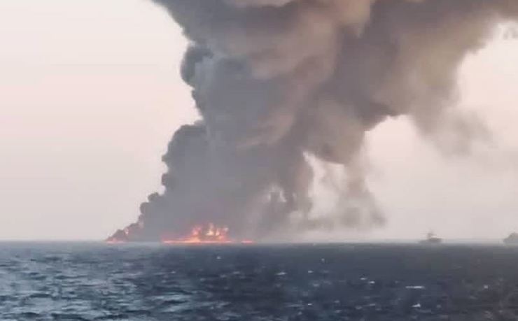 A handout picture made available by the Iranian state TV (IRIB) website shows smoke rising from the largest Iranian navy support ship Kharg in Gulf of Oman, southern Iran, Wednesday. EPA-Yonhap