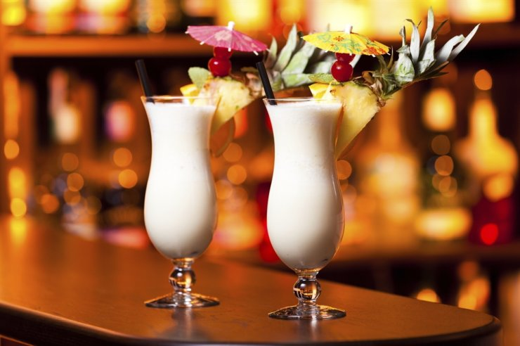 Pina Colada is Puerto Rico's signature cocktail made with rum, coconut milk and pineapple. Courtesy of Booking.com
