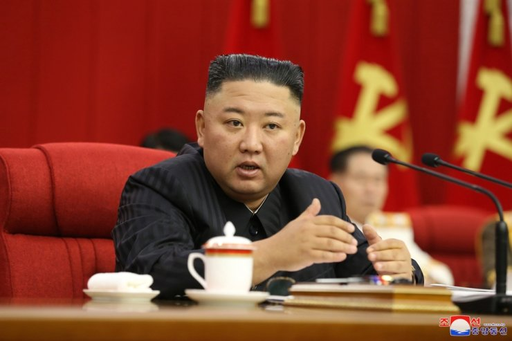 North Korean leader Kim Jong-un presides over a session of the plenary meeting of the eighth Central Committee of North Korea's ruling Workers' Party of Korea in Pyongyang, Thursday, in this photo released by the Korean Central News Agency. Yonhap