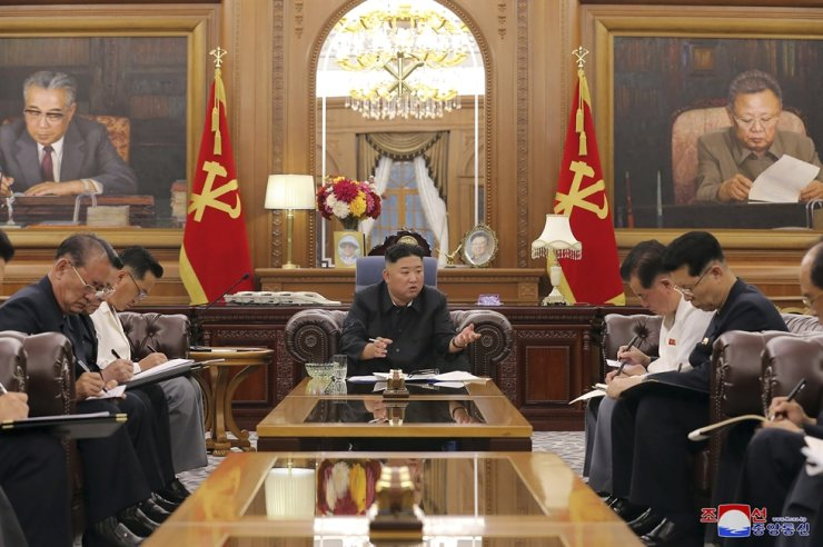 In this photo provided by the North Korean government, North Korean leader Kim Jong-un, center, attends a meeting with senior ruling party officials in Pyongyang, June 7. AP-Yonhap