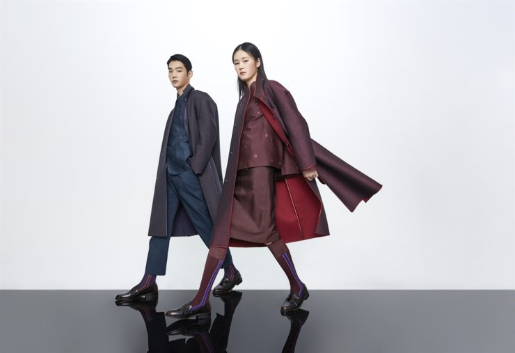 Hanbok-inspired business attire is part of a project launched by the culture ministry and the Hanbok Advancement Center to promote the traditional costume for daily wear. Courtesy of Korea Craft and Design Foundation