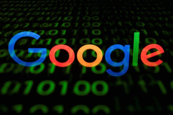 This April 29, 2018, file photo shows the Google logo displayed on a screen and reflected on a tablet in Paris. France's competition regulator on June 7 fined Google 220 million euros ($267 million) after finding it had abused its dominant market position for placing online ads, the latest move by European authorities to take tougher stances against U.S. tech giants. AFP-Yonhap