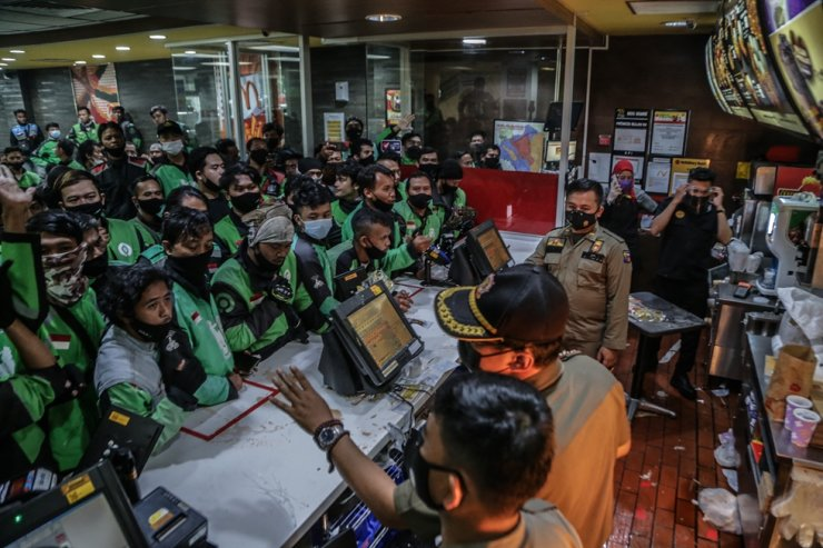Food delivery riders queue up at a McDonald's outlet to buy the new BTS-meal meals for fans, Bogor, Indonesia, June 9.