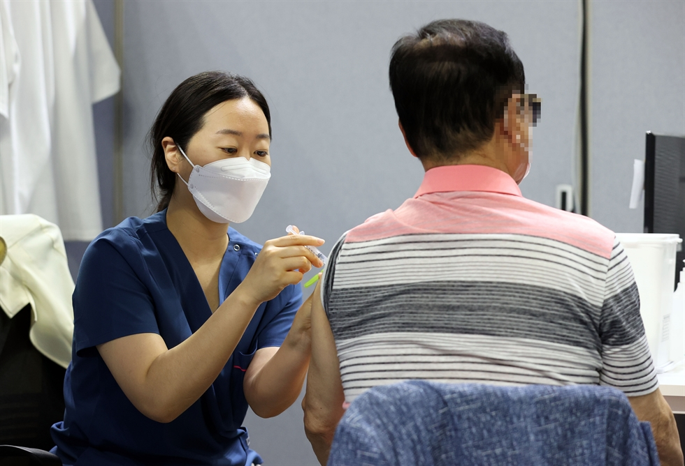 People wait in case of possible side effects after receiving COVID-19 vaccinations at a designated center in Dongjak District, Seoul, Friday. Yonhap