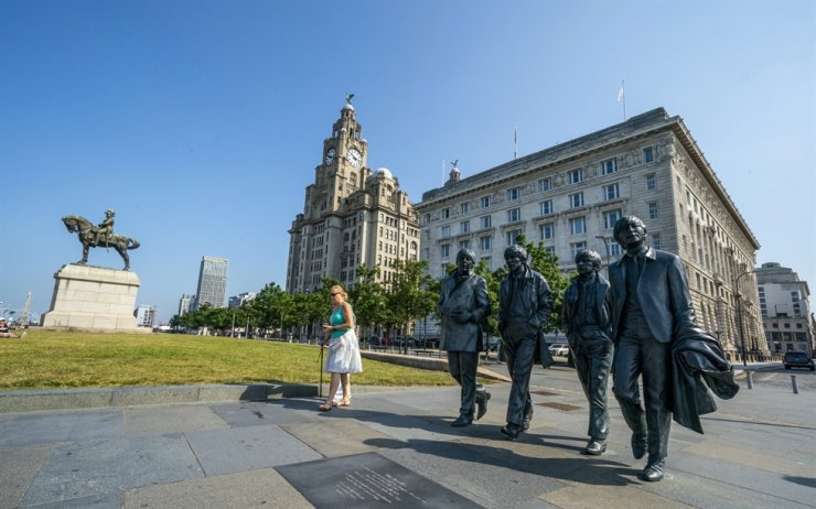 The Beatles statues and Royal Liver Building, center, on the waterfront area of Liverpool, which has been removed from the World Heritage List, July 21. AP-Yonhap