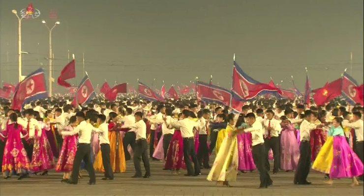 In this frame grab from North Korea's Korean Central Television in May, North Korean young people enjoy dance party at Kim Il-sung Square in Pyongyang. Yonhap