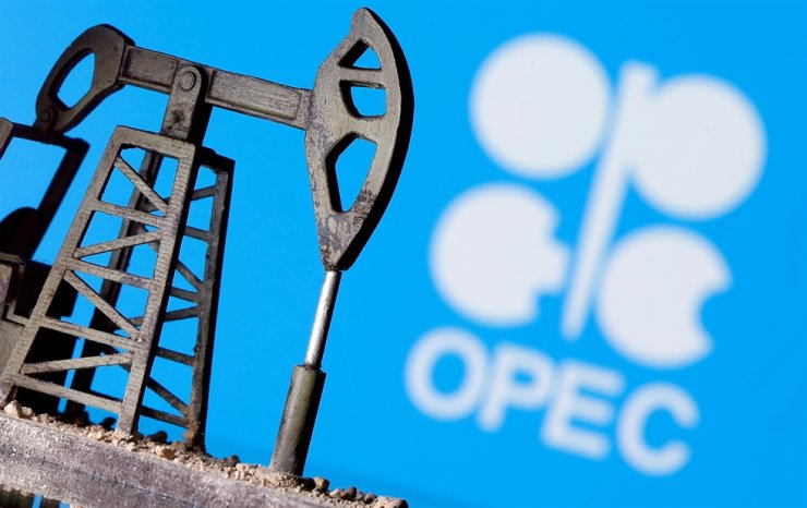 A 3D printed oil pump jack is seen in front of displayed OPEC logo in this April 14, 2020, illustration photo. Reuters-Yonhap