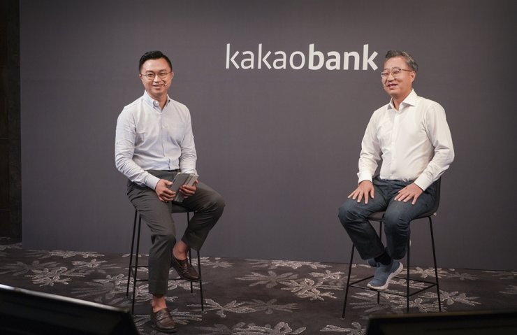 KakaoBank CEO Yun Ho-young, right, attends a virtual press conference, Tuesday. Courtesy of Kakao Bank