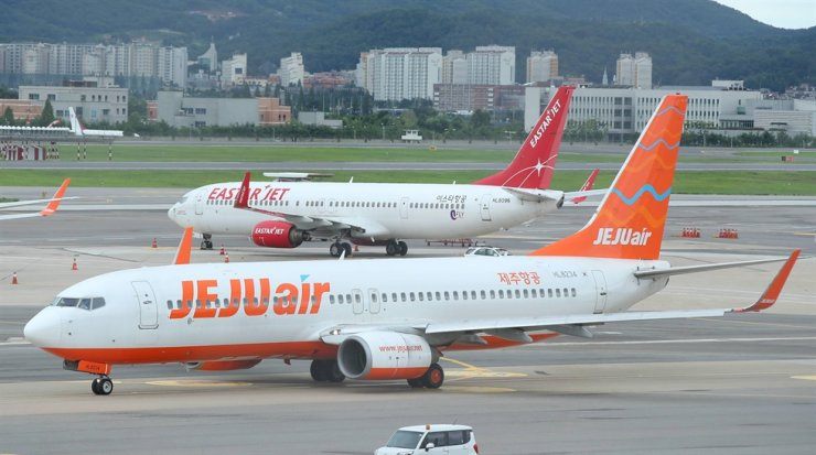 Aircraft owned by low-cost carriers are parked at Gimpo International Airport in Seoul in this July 2020 file photo. Yonhap
