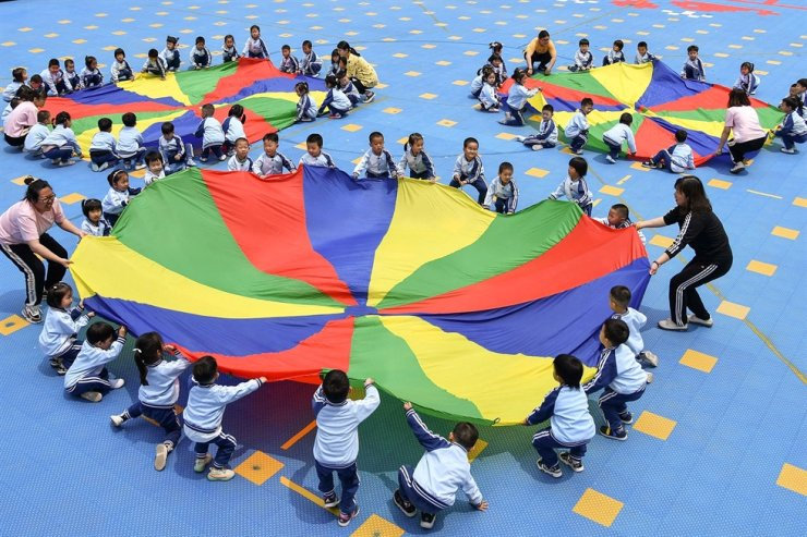 In this May 31 file photo, Chinese children play at a kindergarten in Yantai, China. AFP-Yonhap