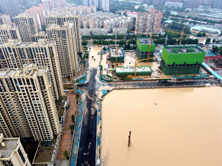 An aerial view shows the flooded areas following heavy rainfall in Zhengzhou, Henan province, China, July 21. Reuters-Yonhap