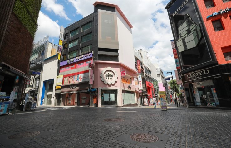 A street in Seoul's Myeongdong, a popular destination for young people and tourists before the COVID-19 pandemic, is almost empty, July 18. Yonhap