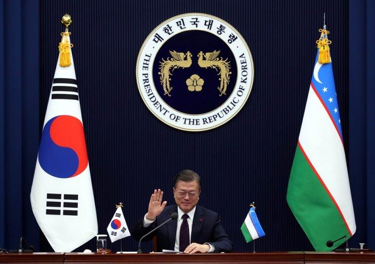 In this Jan. 28 file photo, President Moon Jae-in speaks during online summit with Uzbekistan President Shavkat Mirziyoyev. Korea Times file