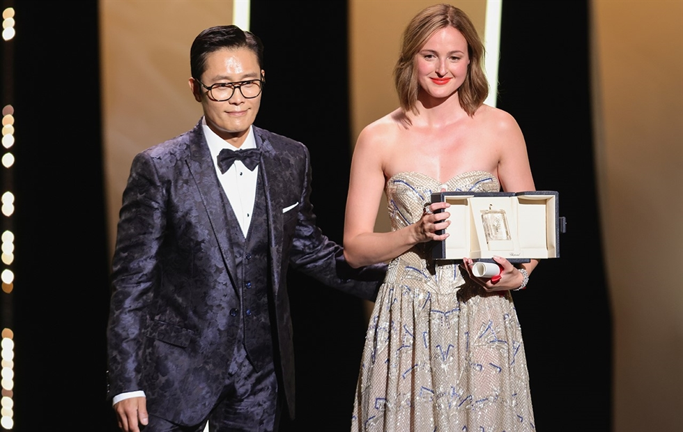Director Yoon Dae-woen, second from left, poses along with other filmmakers Theo Degen (left), Carina-Gabriela Dasoveanu and Rodrigo Ribeyro, after being awarded the 2021 Cinefondation prizes during a ceremony held in the Bunuel Theatre, Friday (CET). Courtesy of the Festival de Cannes