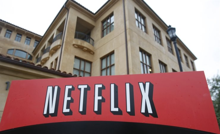 This Jan. 29, 2010, file photo shows the company logo and view of Netflix headquarters in Los Gatos, Calif. Netflix has hired veteran video game executive Mike Verdu, signaling the video streaming service is poised to expand into another fertile field of entertainment. AP-Yonhap