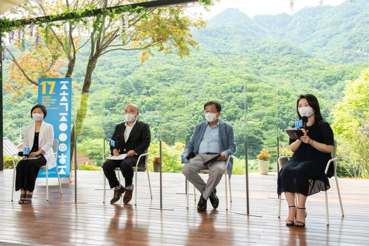 The 17th Jecheon International Music & Film Festival's programmer, Mang Soo-Jin, from left, director Cho Sung-woo, organizing committee head Lee Sang-chun and journalist Jang Sung-ran talk during the online press conference, Wednesday. Courtesy of JIM