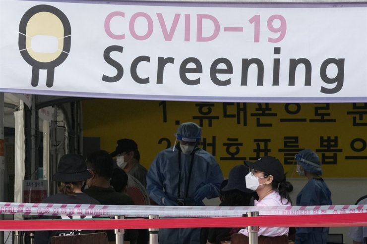 A woman waits to get coronavirus testing at a public health center in Seoul, Wednesday, July 14. AP-Yonhap