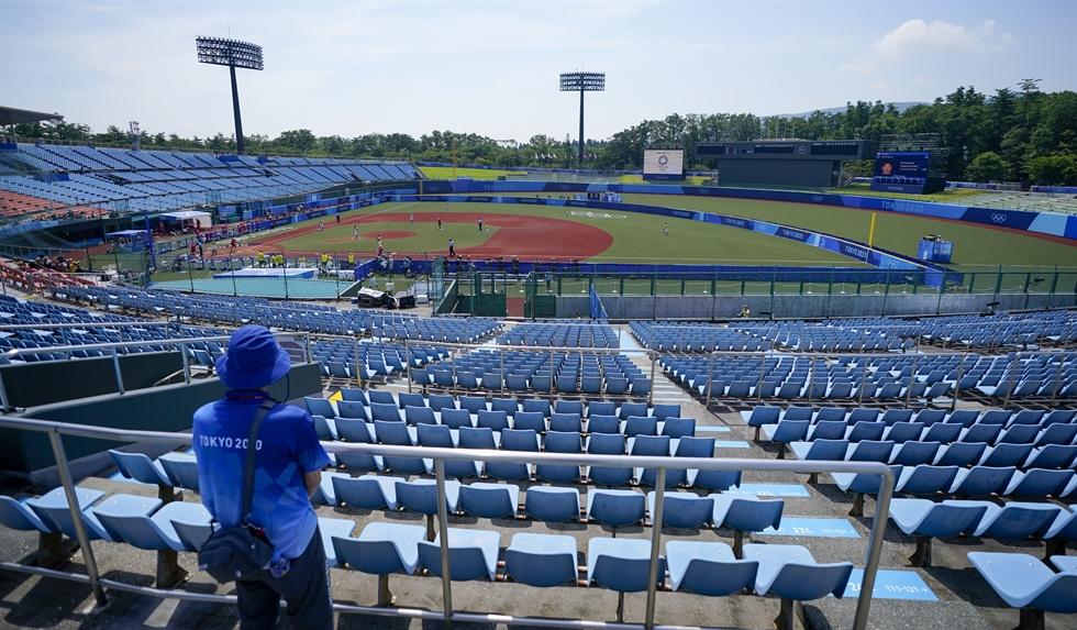 Japan's Minori Naito, right, slides into home base as Australia's Taylah Tsitsikronis catches the ball during the softball game between Japan and Australia at the Summer Olympics, July 21, in Fukushima, Japan. AP-Yonhap