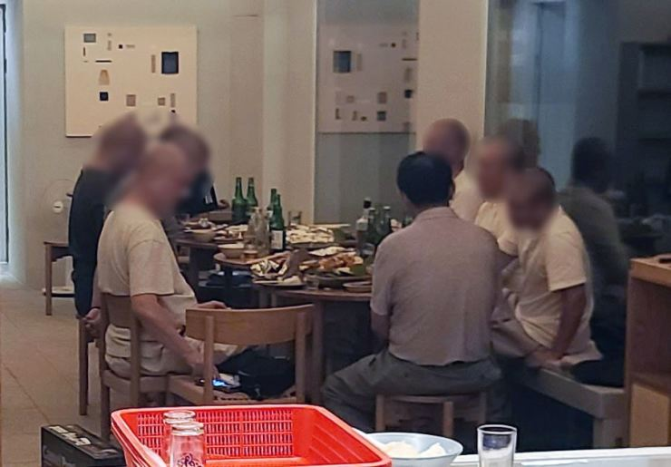 Seen is a photo showing a group of monks having a drinking party in an accommodation facility owned by the Jogye Order of Korean Buddhism, the largest Buddhist sect, on July 19. Yonhap