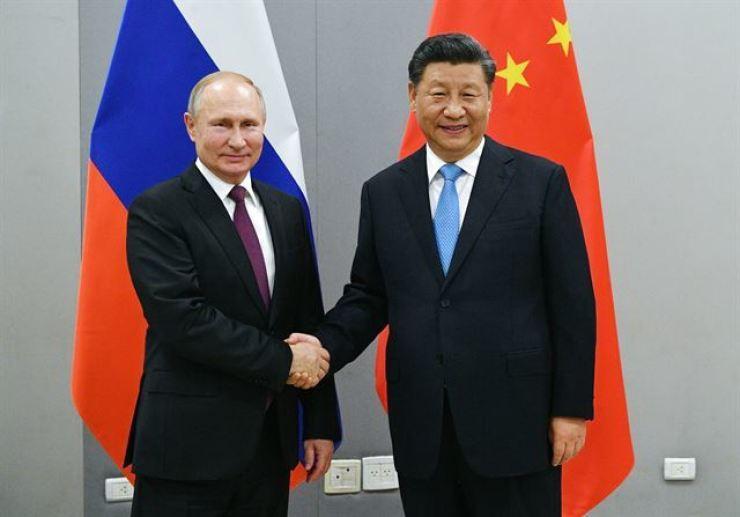 Russian President Vladimir Putin and Chinese President Xi Jinping / AP-Yonhap