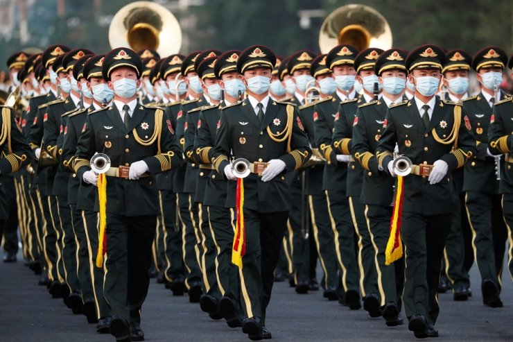 Military band members rehearse before the event marking the 100th founding anniversary of the Communist Party of China, on Tiananmen Square in Beijing, July 1. Reuters-Yonhap
