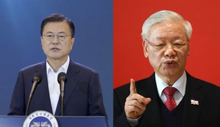 President Moon Jae-in, left, and Vietnam leader Nguyen Phu Trong / Korea Times file