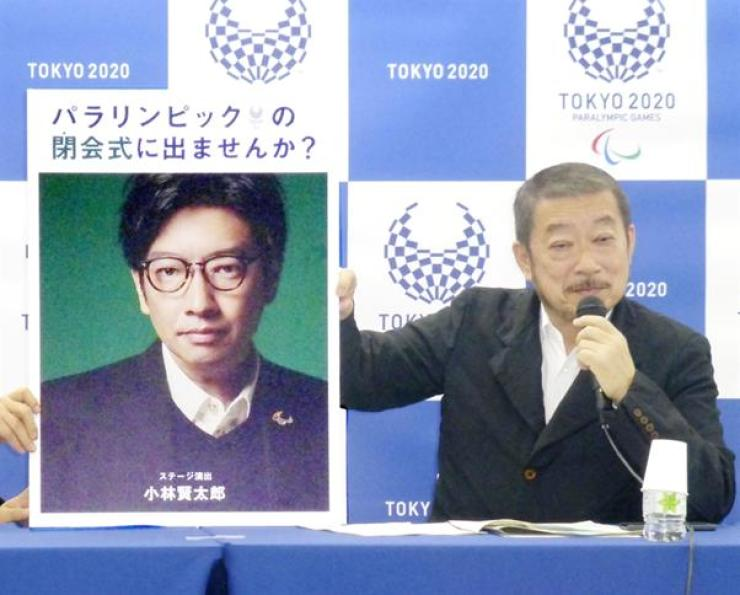 In this Dec. 2019, photo taken by Kyodo, Hiroshi Sasaki, Tokyo 2020 Paralympic Games executive creative director, displays a portrait of Olympics opening ceremony show director Kentaro Kobayashi during a news conference in Tokyo. Reuters-Yonhap